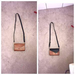 Reversible tan to black purse